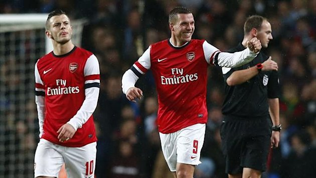 Arsenal's Lukas Podolski (C) celebrates his 2nd goal against Coventry City (Reuters)