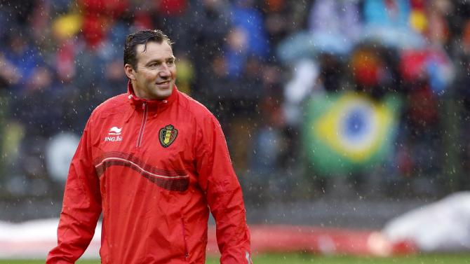 Belgium's soccer team coach Wilmots smiles during a training session in Brussels
