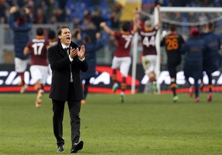 AS Roma's coach Rudi Garcia celebrates at the end of their Serie A soccer match against Genoa at Olympic stadium in Rome