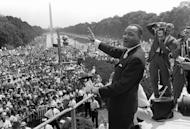 Martin Luther King, Jr., waves to supporters from the steps of the Lincoln Memorial on 28 August 1963