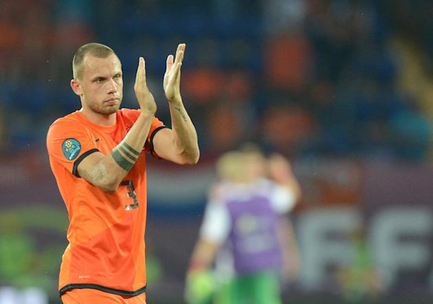 Dutch Defender John Heitinga Applauds  AFP/Getty Images