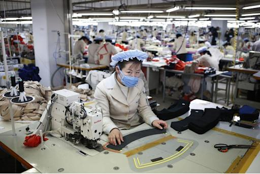 North Korean workers sew clothes in a factory owned by a South Korean company at the Joint Industrial Park in Kaesong just a few hundred metres north of the demilitarized zone that separates the two Koreas
