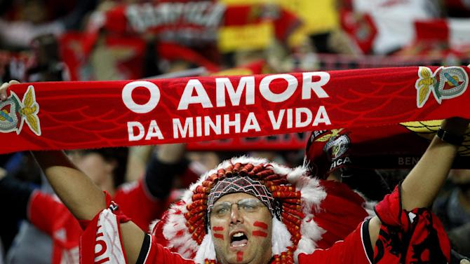 "A Benfica supporter holds a scarf that reads  ""The Love of My Life"" in Portuguese as he cheers prior a Portugal Cup soccer match between Benfica and Sporting at Benfica's Luz stadium in Lisbon, Saturday, Nov. 9, 2013. Benfica won 4-3 in extra time"