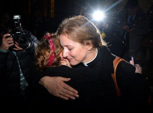 """Two members of the clergy embrace outside Church House in central London on November 20. The Church of England has """"undoubtedly"""" lost credibility after voting to reject the appointment of women bishops, its leader the Archbishop of Canterbury said Wednesday."""