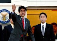 Japanese Prime Minister Shinzo Abe (L), accompanied by Foreign Minister Fumio Kishida (R) leaves Tokyo International Airport to travel to the US, on February 21, 2013. Abe will have talks with US President Barack Obama for the first time since taking power.