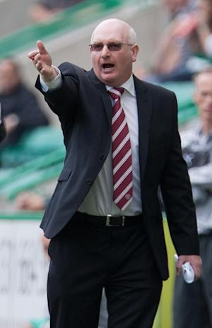John McGlynn was happy to give something back to the Hearts fans