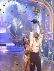 """In this image released by ABC-TV, war veteran and actor J.R. Martinez, right, and his partner Karina Smirnoff hold their award after they were crowned champions of the celebrity dance competition series, """"Dancing with the Stars,"""" Tuesday, Nov. 22, 2011 in Los Angeles. (AP Photo/ABC-TV, Adam Taylor)"""