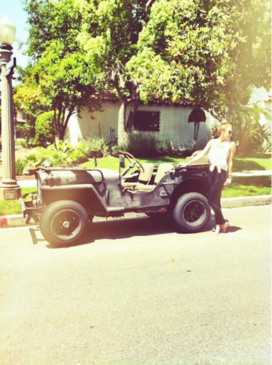 "Celebrity photos: Miley Cyrus tweeted this cute photo of her along with the caption: ""it's a beautiful day in the neighborhood"" [sic]"