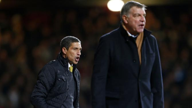 Norwich City's manager Hughton and his West Ham United counterpart Allardyce react during their English Premier League soccer match at the Boleyn Ground in London