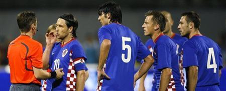 Croatia's captain Niko Kovac and teammates protest against Michel's decision to send Robert Kovac off during their World Cup 2010 qualifying soccer match at Maksimir stadium in Zagreb