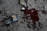 A sandal and a pool of blood remain at the site of an Israeli strike that hit a U.N. school in Beit Hanoun, in the northern Gaza Strip, Thursday, July 24, 2014. Israeli tank shells hit the compound, killing more than a dozen people people and wounding dozen mores who were seeking shelter from fierce clashes on the streets outside, Palestinian officials said, as Israel pressed forward with its 17-day war against the territory's Hamas rulers. (AP Photo/Adel Hana)