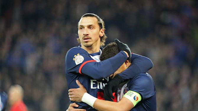 Paris Saint Germain's Zlatan Ibrahimovic of Sweden, left, congratulates Thiago Da Silva after he scored the opening goal during the League One soccer match between Paris Saint Germain and Nantes at the Parc des Princes stadium in Paris, Sunday Jan. 19, 2014