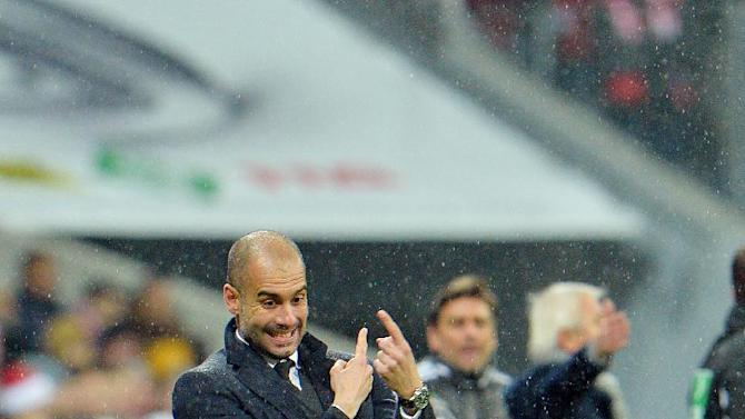 Bayern head coach Pep Guardiola gestures during  the German first division Bundesliga soccer match between FC Bayern Munich and Hamburger SV  in Munich, Germany, Saturday, Dec. 14, 2013
