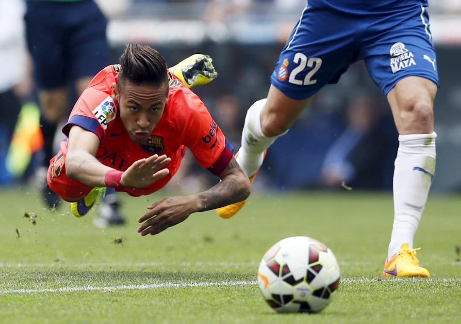 Barcelona's Neymar is tackled by Espanyol's Lucas Vazquez during their Spanish first division soccer match near Barcelona