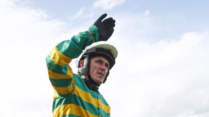 Horse Racing: A.P McCoy salutes the crowd after finishing third in the Handicap Hurdle Race, his last ever competitive race