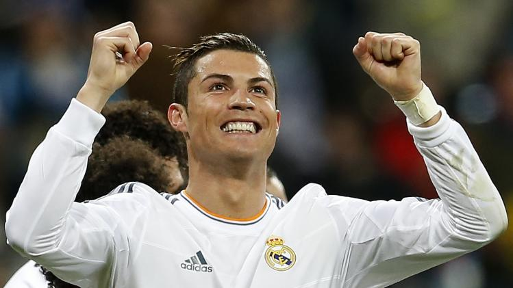 Real Madrid's Cristiano Ronaldo celebrates his second goal against Celta Vigo during their Spanish First Division soccer match at Santiago Bernabeu stadium in Madrid