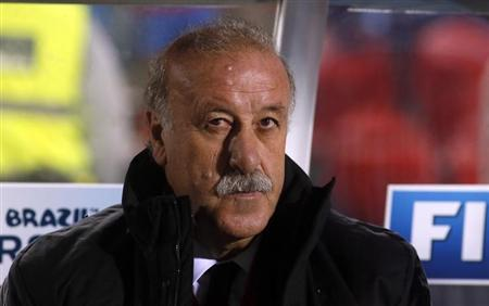 Spain's coach Vicente del Bosque sits in the bench before their 2014 World Cup qualifying soccer match against Belarus at Son Moix stadium in Palma de Mallorca October 11, 2013. REUTERS/Gustau Nacarino