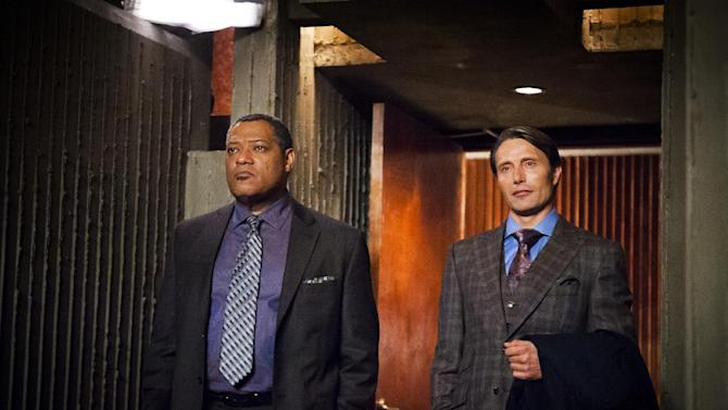 "This undated publicity photo released by NBC shows Laurence Fishburne, left, as Jack Crawford and Mads Mikkelsen as Dr. Hannibal Lecter in episode 105, 'Potage,"" from the TV series, ""Hannibal."" NBC says it's pulling an episode of its serial killer drama ""Hannibal"" out of sensitivity to recent violence, including the Boston bombings. NBC said Friday, Friday, April 19, 2013, that the episode, which was to air next week, features a character who brainwashes children to kill other children. (AP Photo/NBC, Brooke Palmer)"