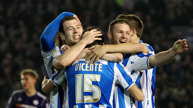 Ashley Barnes, left, put Brighton's victory beyond doubt