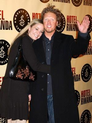 Jake Busey and guest at the Beverly Hills premiere of United Artists' Hotel Rwanda