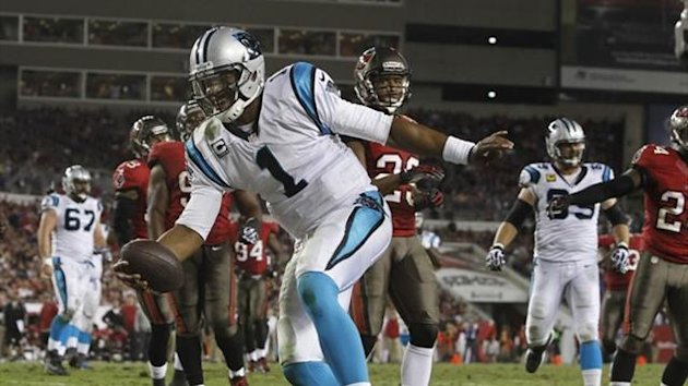 Carolina Panthers quarterback Cam Newton (1) runs the ball in for a touchdown (Reuters)