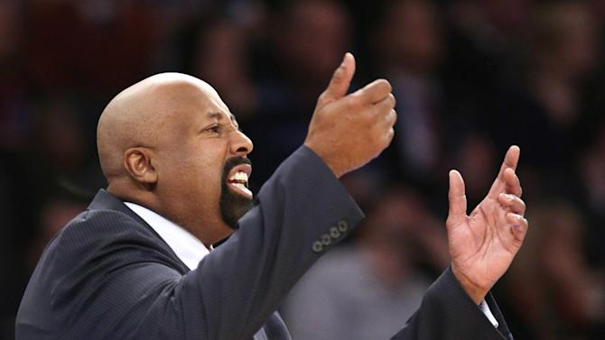 New York Knicks head coach Mike Woodson gestures toward his players in the first half of their NBA basketball game against the Chicago Bulls at Madison Square Garden in New York, Wednesday, Dec. 11, 2013