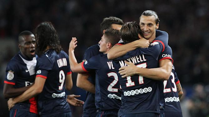Paris Saint Germain's forward Zlatan Ibrahimovic from Sweden, right, celebrates with Paris Saint Germain's defender Maxwell from Brazil, after he scores a goal, during his French League One soccer match against Monaco, at the Parc des Princes stadium, in Paris, Sunday, Sept. 22, 2013