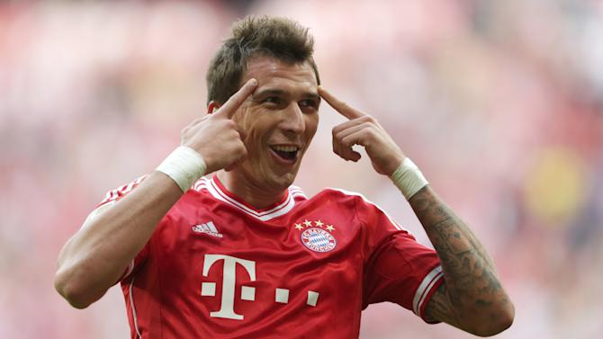 Bayern's Mario Mandzukic of Croatia celebrates after scoring his side's second goal during the German first division Bundesliga soccer match between FC Bayern Munich and Hertha BSC Berlin, in Munich, southern Germany, Saturday, Oct. 26, 2013