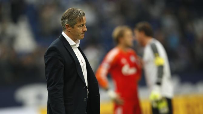 Schalke 04's coach Keller leaves the field after the German first division Bundesliga soccer match against Borussia Dortmund in Gelsenkirchen