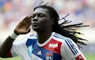 Lyon's Bafetimbi Gomis salutes the crowd after scoring against Montpellier during the 2012 edition of the Champions Trophy at Red Bull Arena in Harrison, New Jersey. French Cup holders Lyon kicked off the new season by beating title-holders Montpellier on penalties to win the Champions Trophy