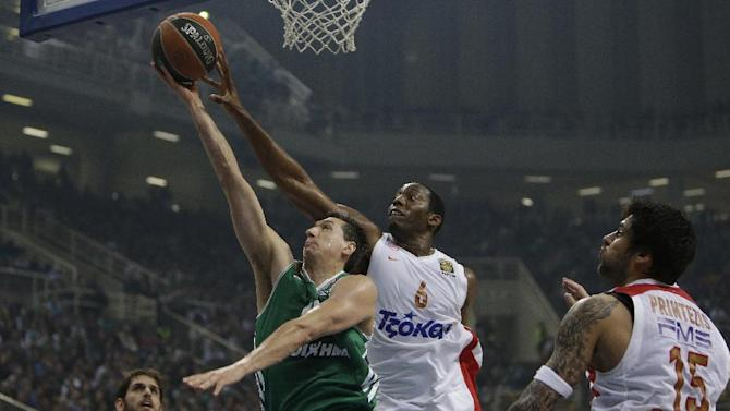 Panathinaikos' Dimitris Diamantidis, left, is stopped by Olympiakos' Bryant Dunston during their Euroleague basketball match of Top 16 at the Olympic Indoor Arena in Athens, Thursday, Feb. 20, 2014