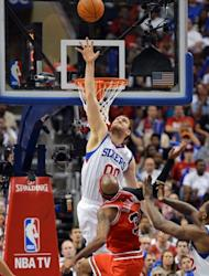 Spencer Hawes of the Philadelphia 76ers jumps to block a shot by Chicago Bulls' Richard Hamilton during game three of the Eastern Conference first-round NBA playoff series on May 4. The 76ers rallied to beat the Bulls 79-74 and gain a 2-1 lead