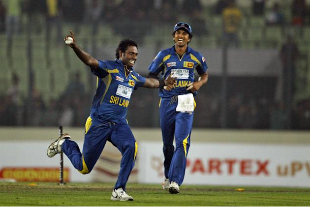 Sri Lanka's Angelo Mathews, left, and Dinesh Chandimal celebrate their win over Bangladesh during their first one day international cricket match in Dhaka, Bangladesh, Monday, Feb. 17, 2014. Sri Lanka
