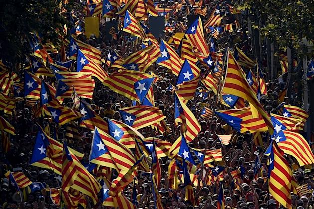 "Demonstrators waving ""Estelada"" flags (Catalan independentist flags) during celebrations of the ""Diada"" (Catalonia National Day) in Barcelona on September 11, 2014"