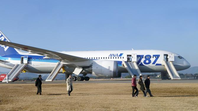 In this photo taken by a passenger and distributed by Japan's Kyodo News, passengers leave an All Nippon Airways Boeing 787 after it made an emergency landing at Takamatsu airport in Takamatsu, Kagawa Prefecture, western Japan, Wednesday, Jan. 16, 2013. ANA said a cockpit message showed battery problems and a burning smell was detected in the cockpit and the cabin, forcing the 787 on a domestic flight to land at the airport. (AP Photo/Kyodo News) JAPAN OUT, MANDATORY CREDIT, NO LICENSING IN CHINA, HONG KONG, JAPAN, SOUTH KOREA AND FRANCE