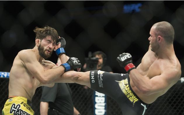 Chad Laprise, right, from Canada, lands a kick to the body of Bryan Barberena, from the United States, during their UFC 186 mixed martial arts lightweight fight in Montreal, Saturday, April 25, 2015.