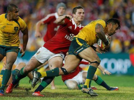 Lions' North tackles Wallabies' Ioane during their rugby union test match at Suncorp Stadium in Brisbane