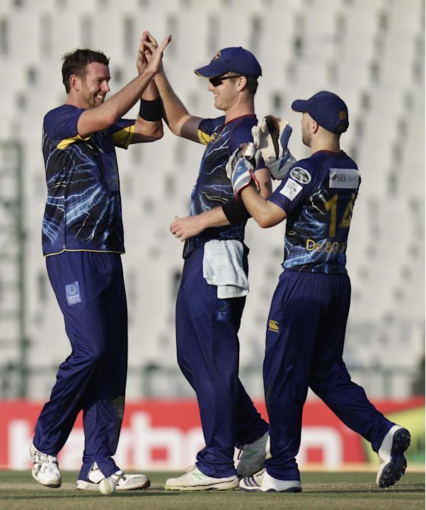 Butler celebrates after taking a wicket during the Champions League T20, 3rd Match between Kandurata Maroons and Otago Volts at Mohali stadium, Chandigarh on Sept. 18, 2013. (Photo: IANS)