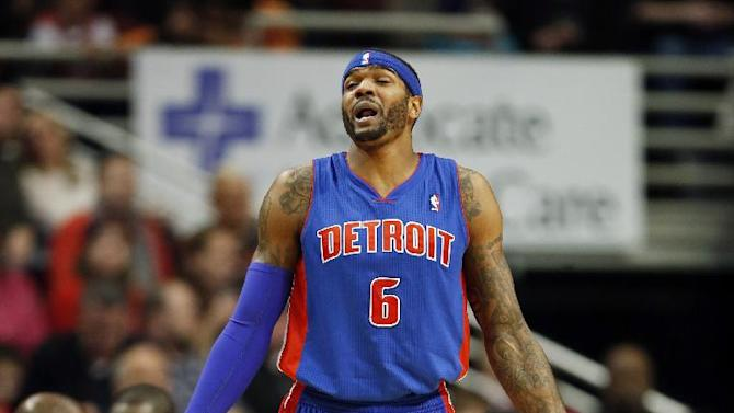 Detroit Pistons forward Josh Smith reacts after being called for a foul against the Chicago Bulls during the first half of an NBA basketball game in Chicago, Saturday, Dec. 7, 2013
