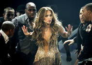 Jennifer Lopez performs at the 39th Annual American Music Awards on Sunday, Nov. 20, 2011 in Los Angeles. (AP Photo/Matt Sayles)
