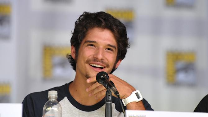 """IMAGE DISTRIBUTED FOR MTV - Tyler Posey speaks at the """"Teen Wolf"""" panel at the San Diego Convention Center on Day 2 of Comic-Con International on Thursday, July 18, 2013, in San Diego, Calif. (Photo by John Shearer/Invision for MTV/AP)"""