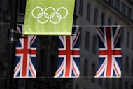 The Olympic rings are seen in front of the union flags in central London