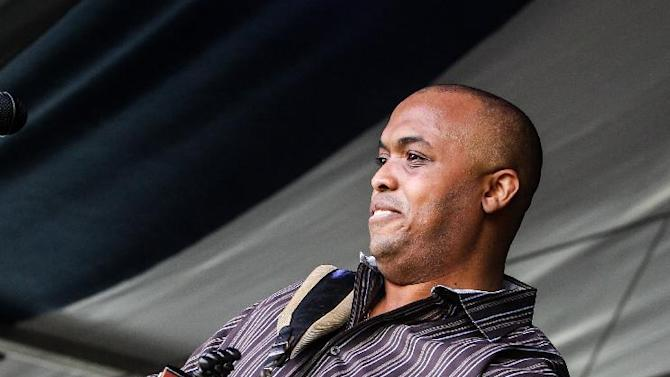 Corey Ledet and his Zydeco band perform on the Fais Do Do stage during the New Orleans Jazz and Heritage Festival in New Orleans, Friday, April 26, 2013. (AP Photo/Doug Parker)