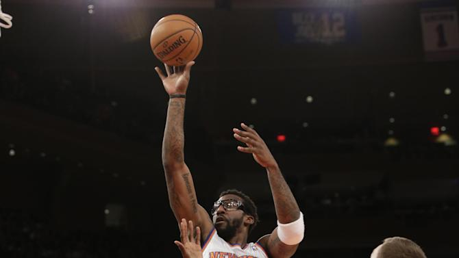 New York Knicks forward Amare Stoudemire (1) shoots over Chicago Bulls center Nazr Mohammed (48) and Chicago Bulls forward Erik Murphy (31) in the first half of their NBA basketball game at Madison Square Garden in New York, Wednesday, Dec. 11, 2013