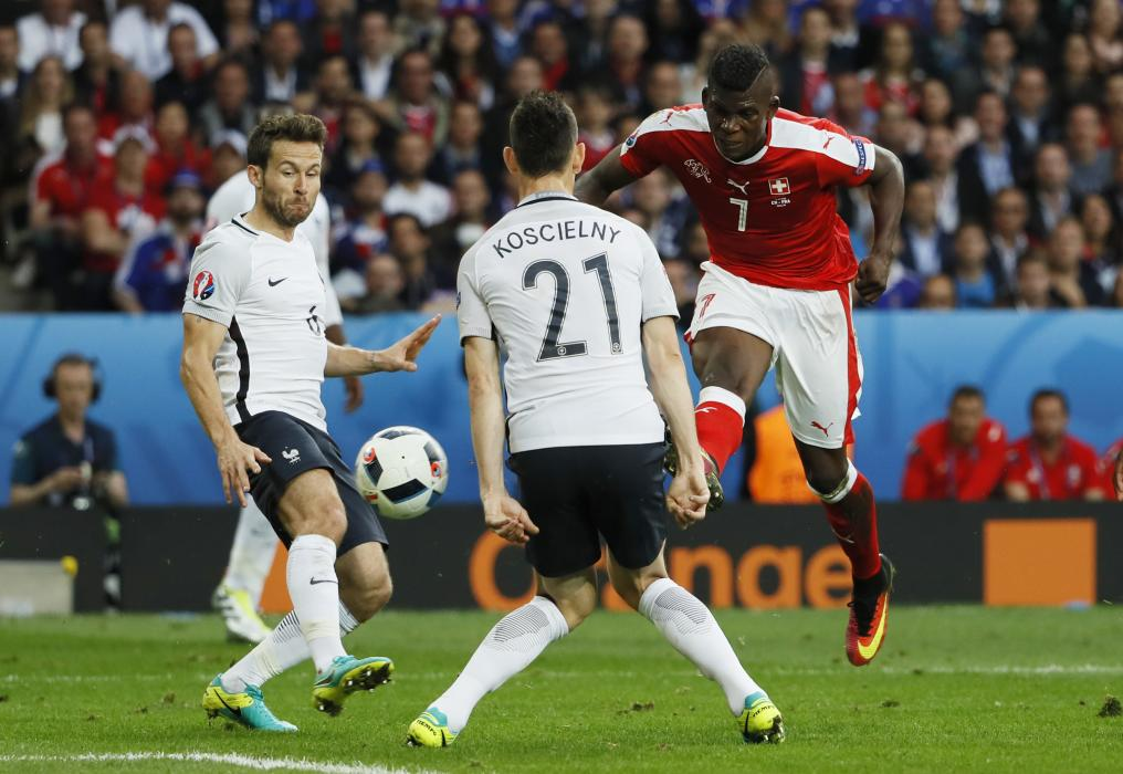 Switzerland's Breel Embolo has his shot blocked by France's Laurent Koscielny