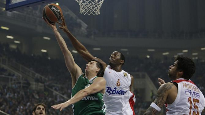 Panathinaikos' Dimitris Diamantidis, left, is stopped by Olympiakos' Bryant Dunston during their Euroleague basketball match of Top 16 at the Olympic Indoor Arena in Athens, Thursday, Feb. 20, 2014. (AP Photo/Thanassis Stavrakis)