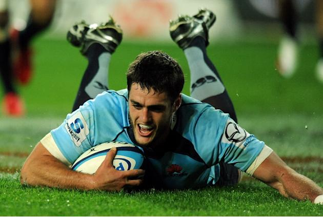 New South Wales Waratahs' skipper Dave Dennis scores a try during a Super 15 rugby union match