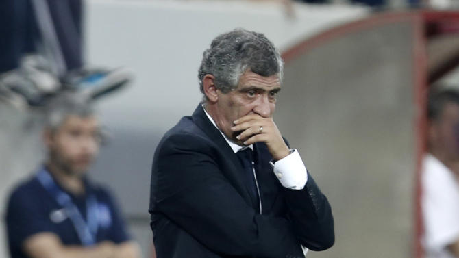 Greece's coach Fernando Santos from Portugal watches his players during a World Cup Group G qualifying soccer match against Liechtenstein at the Karaiskaki stadium in the port of Piraeus, near Athens, Tuesday, Oct. 15, 2013. Greece won 2-0