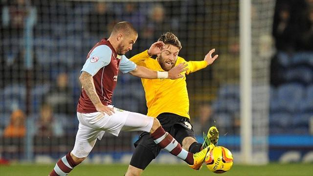 Football - Kightly sends Clarets to the summit