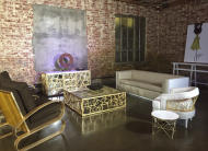 """This Jan. 25, 2017 photo shows pieces from the Badgley Mischka Home Collection on display in Los Angeles. Design duo Mark Badgley and James Mischka, known for their show-stopping red carpet gowns, are bringing all the glamour of their fashion show to a living room near you. The designers describe their first-ever Badgley Mischka Home Collection, launching Tuesday, Feb. 14, 2017, as """"couture furniture"""" infused with old Hollywood glamour. (AP Photo/Nicole Evatt)"""